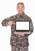 Mature Soldier Showing Laptop