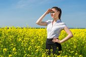 business woman at the yellow flower field