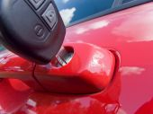 pic of car key  - key in the lock of red car - JPG