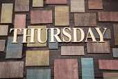 foto of thursday  - Wooden letters forming word THURSDAY written on wooden background - JPG