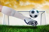 Composite image of close up of football player kicking ball against goalpost on grass under yellow s