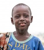 AFRICA, TANZANIA-FEBRUARY 9, 2014: Unidentified boy of Masai  tribe looking to the camera on Februar
