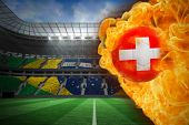 Composite image of fire surrounding switzerland flag football against large football stadium with br