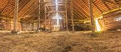 Panorama interior of old farm barn with straw