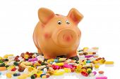 foto of placebo  - pills lying next to a piggy bank - JPG