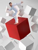 Concept picture of a man riding a flying red cube