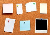 stock photo of old post office  - Blank instant photo and note papers on a cork board - JPG