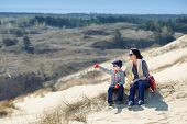 Mother and son together on sand Dunes in Neringa