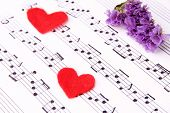 foto of heart sounds  - Red paper hearts on music book - JPG
