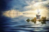 Fishing boat at sea at sunset
