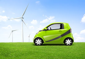 picture of windmills  - Electric green car in the outdoor with a view of windmill behind it - JPG