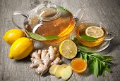picture of ginger  - Cup of ginger tea with honey and lemon on wooden table - JPG