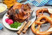 Schweinshaxe (German Pork Knuckle) with pickled cabbage and pretzel