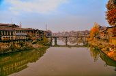 foto of jammu kashmir  - Scenic view of bridge across Jhelum river in town of Srinagar in India summer capital of Jammu and Kashmir - JPG