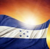 Honduras flag in front of bright sky