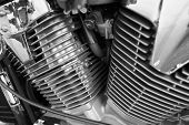 Motorcycle engine, metallic background with exhaust pipes
