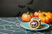 stock photo of spiderwebs  - Tasty Halloween cookies on plate - JPG