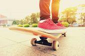 skateboarding woman legs on skateboard