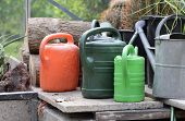 Various watering cans