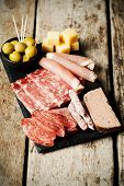 foto of charcuterie  - Charcuterie assortment and olives on wooden background