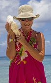 Senior woman holding shell