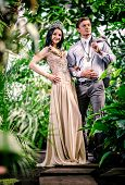 image of tiara  - Gorgeous lady in long evening dress and with tiara on a head and handsome man in classic suit - JPG