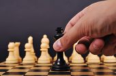 foto of chessboard  - Black Chess King makes a checkmate Black King on chessboard - JPG