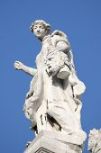 stock photo of beheaded  - Angel statue on top of Santa Maria della Salute Cathedral in Venice, Italy