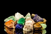 foto of uncut  - various gemstones uncut and Tumble finishing with black background and reflection - JPG