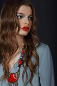 Young Woman With Bright Makeup And Necklace