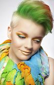 Young Woman With Colorful Makeup And Short Painted Coiffure