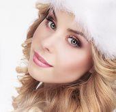 Cute Young Woman In Furry White Cap