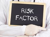 Постер, плакат: Doctor Shows Information On Blackboard: Risk Factor