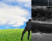 Businessman Pushing Away Stormy Sea Wall