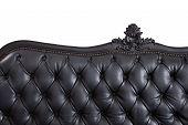 Close - up black leather backrest background