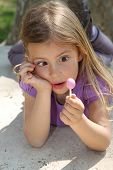 Girl looking at lollipop