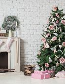 Christmas tree with ornaments in a corner of room