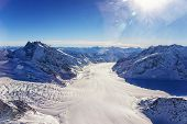 Swiss Aletch Glacier Crossing Flows Helicopter View In Winter