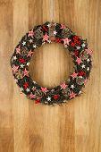Decorated Christmas Door Wreath Gingham Stars On Sapele Wood Background
