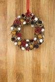 Decorated Christmas Wreath Walnuts And Pine Cones On Sapele Wood Background