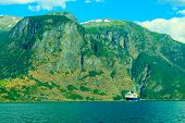 Tourism And Travel. Cruise Ship On Fjord In Norway.