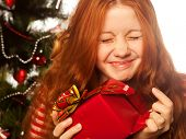 picture of cheerful redhair girl with gift box. Three background.
