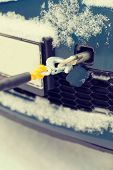 transportation, winter and vehicle concept - closeup of towed car with towing rope