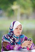 7466210 Royalty Free Stock Photo: Beautiful mature Muslim woman in thinking pose ...
