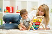 image of home addition  - kid and mother playing with abacus at home - JPG