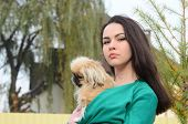 Teen girl with small dog.Near Kiev,Ukraine