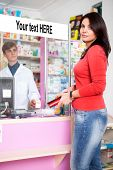 Woman Client In Drugstore With Pharmacist