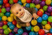 Boy among balls