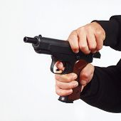 Hands reload semi-automatic pistol on white background