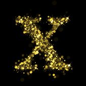 Sparkling Letter X on black background. Alphabet of golden glittering stars (glittering font concept). Christmas holiday illustration of bokeh shining stars character..